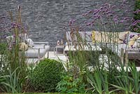 The sunken seating area shielded by a border of Verbena bonariensis, Calamagrostis x acutiflora 'Karl Foerster' and Buxus sempervirens balls used to give a sense of privacy