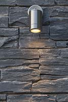 Lighting feature on a dry stone slate wall
