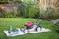 Tools required for performing a full maintenance on your lawnmower. Wax coated sheet, multi purpose oil, lawnmower oil, tray, brush, trowel, sharpening stone, socket and spanner set , spark plugs, air filter and a nut wrench