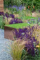 Raised turf cubes and wildlife friendly purple and green planting in 'The Perfect Lawn' at RHS Tatton Flower Show 2015