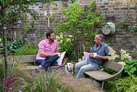 Derek Brewster and Nic Howard, garden designer, with Harry, the pet beagle, relax in their small, irregularly shaped courtyard garden measuring 13m corner to corner, on the longest side.