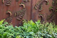 Rusted steel fern wall panel fence, planting of Ferns, Hosta, Constraining Nature garden - designed by Kate Durr Garden Design - Best Festival Garden award and a gold medal - RHS Malvern spring festival 2015