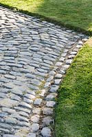 Cobble paths bring texture to the Courtyard Garden at Bury Court Barn, Bentley, Hants, UK