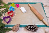 Materials required are a rolling pin, modelling clay, wooden skewer, heart shaped cutters and a variety of conifer foliage