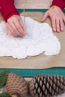 Decorative Clay Hearts. Use a wooden skewer to create small holes in the clay hearts for hanging purposes