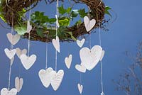Decorative Clay Hearts. Clay hearts featuring impressions from conifer foliage, hanging from an Ivy covered wreath