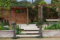 Detail of English style garden, with recycled timber pergola.
