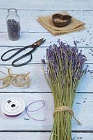 Lavender Hearts. Materials required are sprigs of Lavender, needle, purple string, hessian, heart shaped object, scissors and pencil