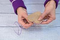 Lavender Hearts. Use a needle and the purple string to sew the two hessian hearts together to form a satchel