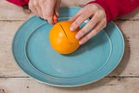 Orange Lantern. Slice the Orange in half over a plate