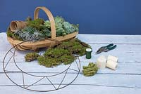 Materials required are Moss, Succulents, Peat free fibre pots, Secateurs, Candles, Wreath frame, Florist wire and some thick string