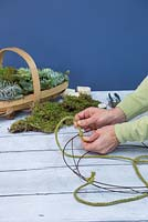 Succulent Wreath. Tie the thick string to four corners of the wreath frame