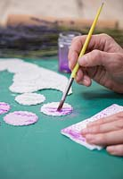 Painting clay tablets that feature Lavender imprints