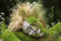 Close up of a land sculpture of a lady resting. The 4Head Garden of Dreams, Design Marney Hall co designer Heather Yarrow, Chelsea Flower Show 2006