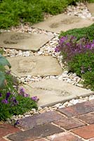Path with footprints and thyme - Thymus vulgaris edging