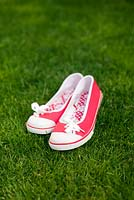 Red shoes on lawn