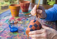 Tartan Painted pots. Paint the pots in a chequered formation to recreate the tartan pattern