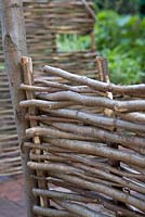 Woven hazel fencing - The Pilgrim's Rest Garden, Silver-Gilt Flora medal winner for Courtyard Garden. RHS Chelsea Flower Show, 2009