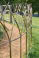 Detail of willow fencing - Gardening Amidst Ruins: A Homage to Capability Brown, RHS Malvern Spring Festival 2016