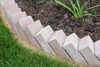 Brick Edging. Detail of finished Clinker brick sawtooth style edging