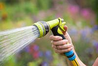 Watering with a spray hose
