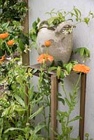 Calendulas and decorative pot - OIKOS, Designer: Mathieu Locret et al, Festival International des Jardins 2016, Domaine de Chaumont sur Loire, France