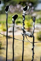 Garden fence with details of animal figures. Garden of Paul Gilbert, blacksmith and sculptor