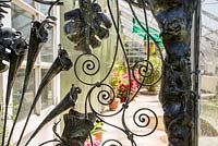 Garden gate on greenhouse. Garden of Paul Gilbert, blacksmith and sculptor