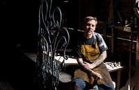 Paul Gilbert, blacksmith and sculptor, in his workshop