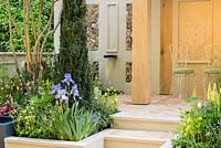 A Suffolk Retreat. An Arts and Crafts inspired garden made from local Suffolk artisinal crafts. Sponsor: The Pro Corda Trust. Designer: Freddy Whyte. RHS Chelsea Flower Show, 2016.