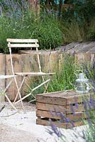 Bistro chair with wooden crate for a table, surrounded by Lavender - The Lavender Garden, RHS Hampton Court Palace Flower Show 2016