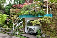 Senri-Sentei Garage Garden, depicting a two tier structure housing an antique mini, with a roof garden and area for the family to sit and relax - RHS Chelsea Flower Show 2016, Designer: Kazyuki Ishihara, Sponsor: Senri-Sentei Project