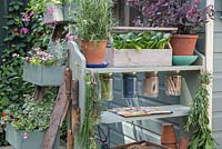 A gardening storage unit made from upcycling book shelves