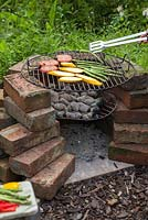 Grilling fresh vegetables on a homemade barbecue