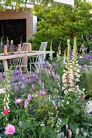 Digitalis 'Glory of Roundway', foxglove, part of the soft pastel planting enclosing an outdoor living space. The LG Smart Garden, Designer Hay Joung Hwang, RHS Chelsea Flower Show 2016
