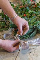 Attaching a decorative bow to florist stub wire