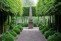 Hornbeam avenue with stone obelisk. Mitton Manor, Staffordshire.
