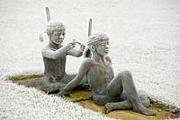 Bronze sculpture of children playing at native American squaws