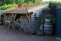 Wood store with living roof