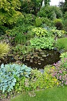 Gap photos specialising in garden and plant photography for Small round pond