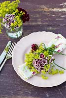 Summer table place setting with Dianthus barbartus - Sweet Williams and Alchemilla mollis