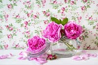 Pink roses arranged in glass jar