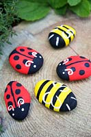 Garden craft making painted Bumble bees and Ladybirds with stones. Finished Ladybirds and Bumble bees