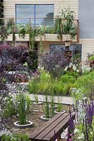 The RHS Greening Grey Britain Garden - view of garden, pond, and balcony - RHS Chelsea Flower Show 2017