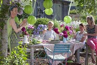 Garden party in early summer under the walnut tree