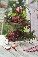 Etagère metal decorated with fruit and wild fruits