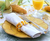Zea ( corn ) grains strung with pearls as napkin rings