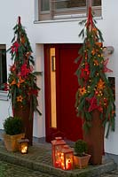 Red door decorated for Christmas