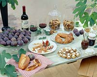 Table setting with sweet figs dishes