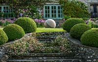 Stone steps and topiary at The Long House in Sussex